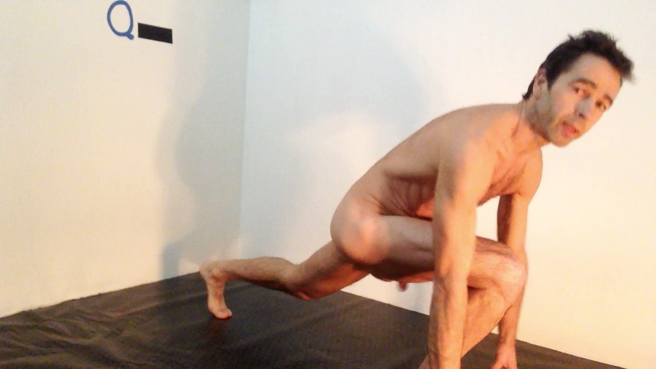 Personal Trainer naked showing an exercise