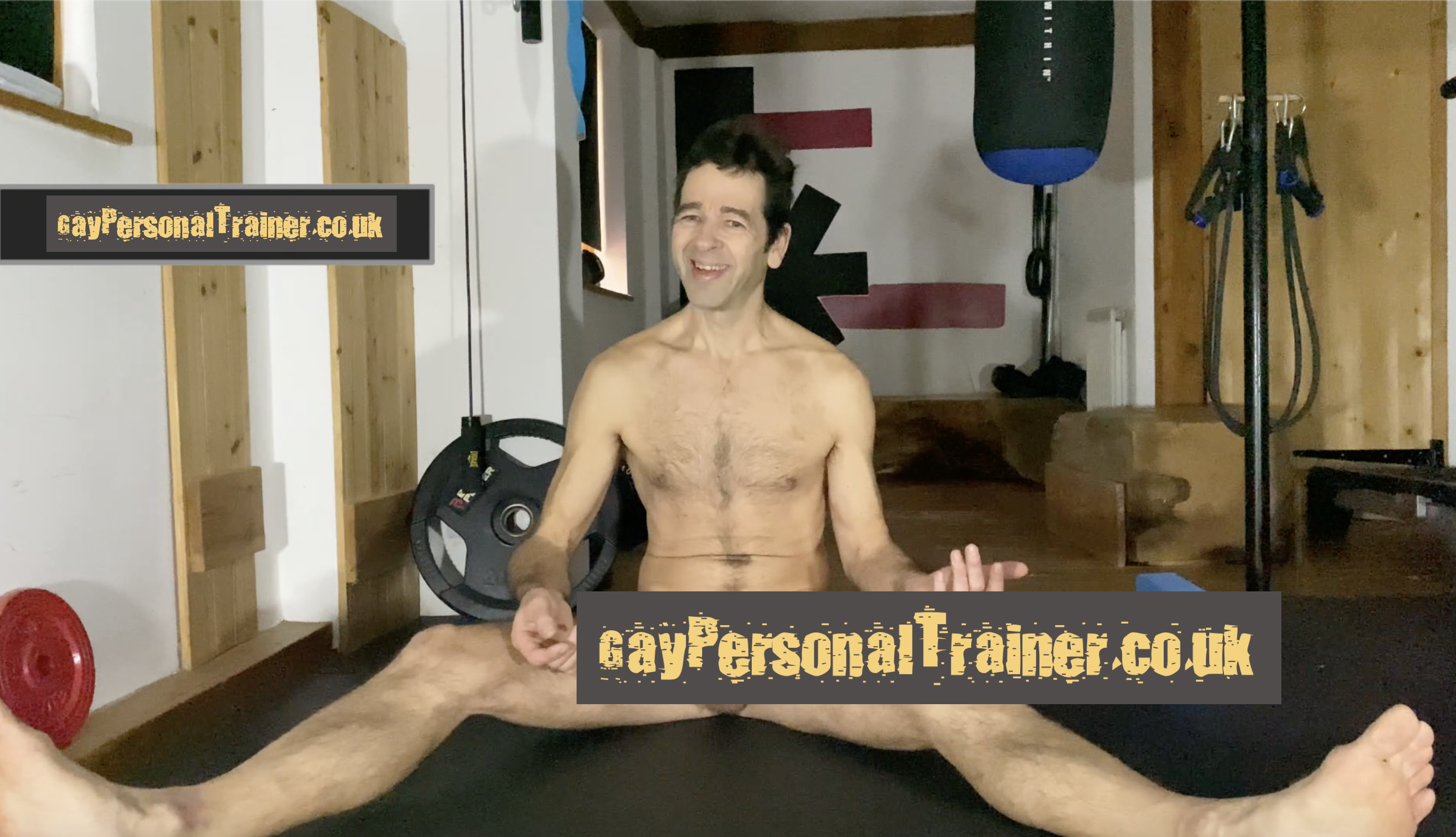 gay personal trainer naked on the floor with some writing to hide penis from view